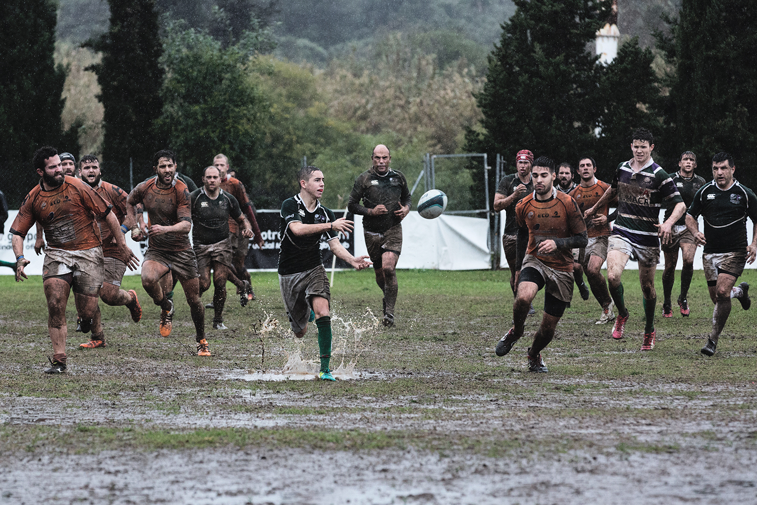 Players in rugby match passing the ball
